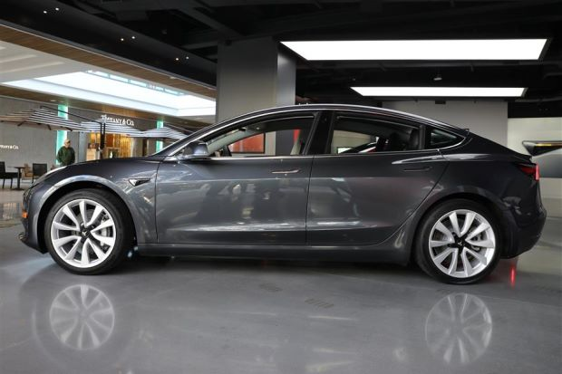 A Tesla Model 3 in a showroom in Los Angeles, California, recently. Semi-autonomous driving systems such as Tesla's Autopilot require humans and robots to share the driving duties. ? Reuters