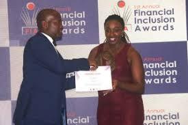 Apptivate Africa Corporate Relations Manager Irene Kioko receiving an award from Fini Awards 2019 head Calvin Jodisi.