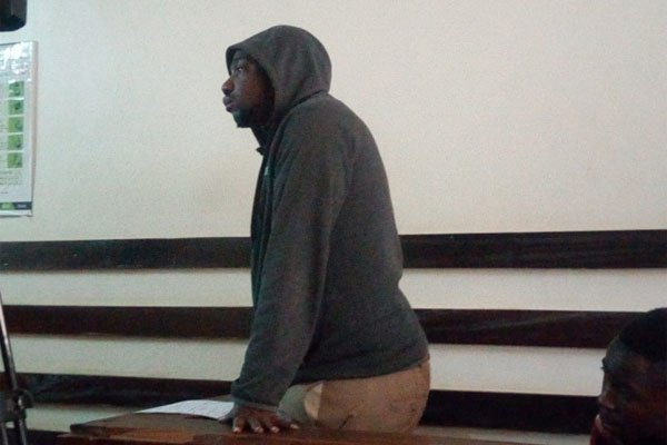 Samuel Ndirangu, in court after urinating in a local man's living room