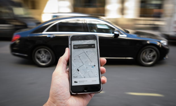 TfL said it had found several breaches that put Uber passengers and their safety at risk. Photograph: Leon Neal/Getty Images
