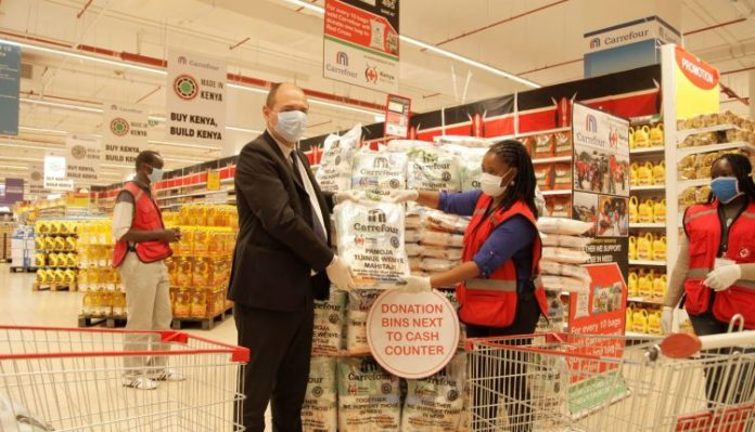 Carrefour Kenya Country Manager, Franck Moreau and Red Cross Deputy Secretary General Annette Msabeni during the donation campaign launch at Carrefour Two Rivers branch.
