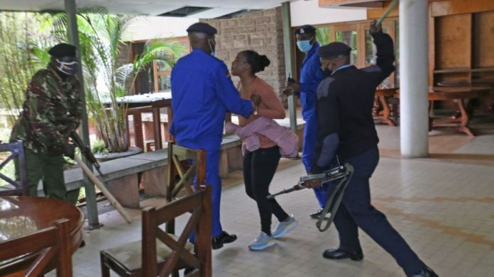 Photos of MCA Patricia Mutheu Been Clobbered by Four Policemen